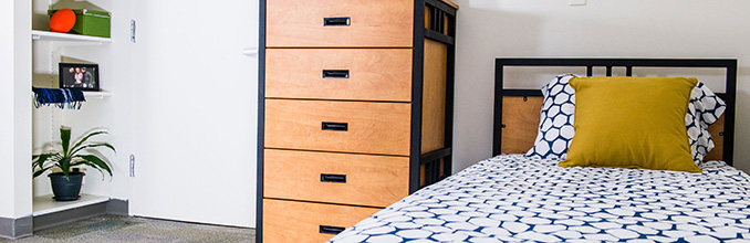 Bedroom inside of the Lasdon apartment unit.