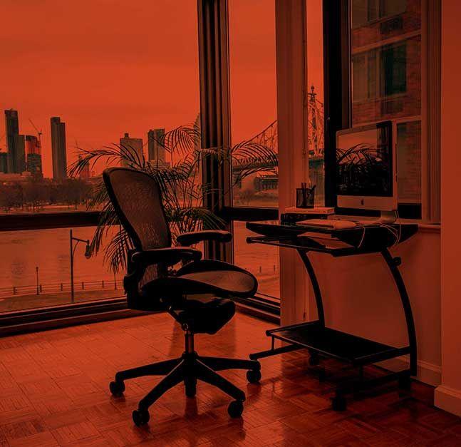 Desk overlooking Manhattan skyline.